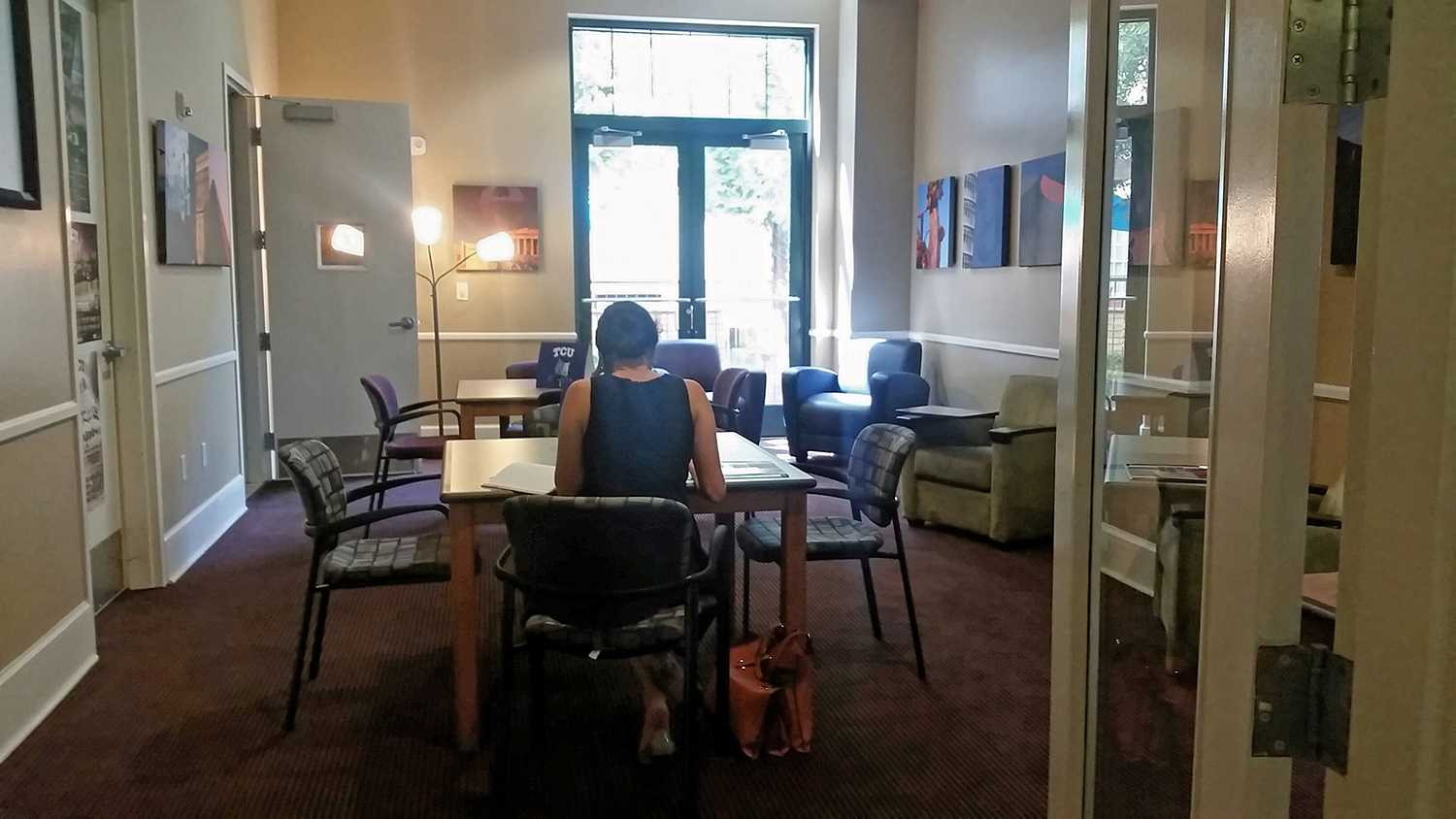 A student studies in the new transfer center space in the GrandMarc.