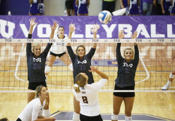 Three Horned Frogs attempt to block at the net.