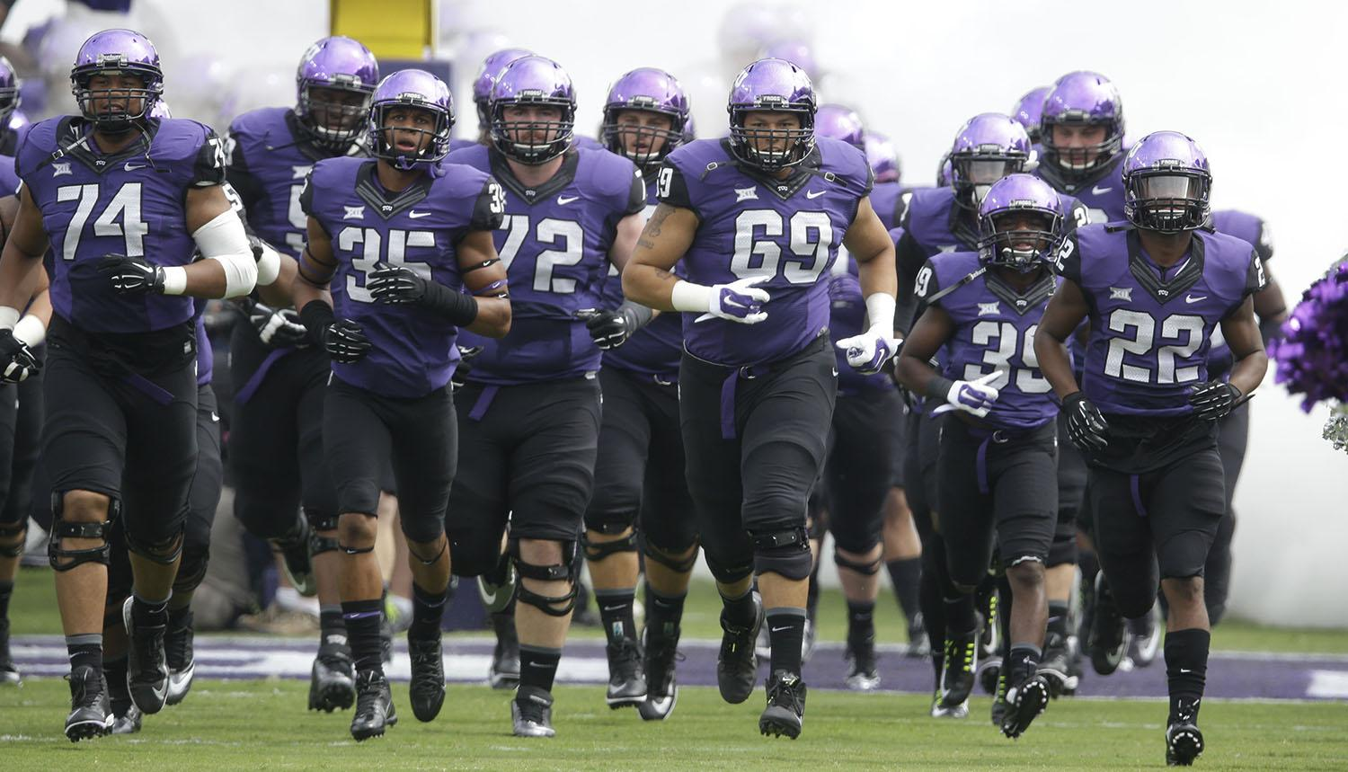 TCU players take the field  before an NCAA college football game, Saturday, Sept. 13, 2014, in Fort Worth, Texas. (AP Photo/LM Otero)