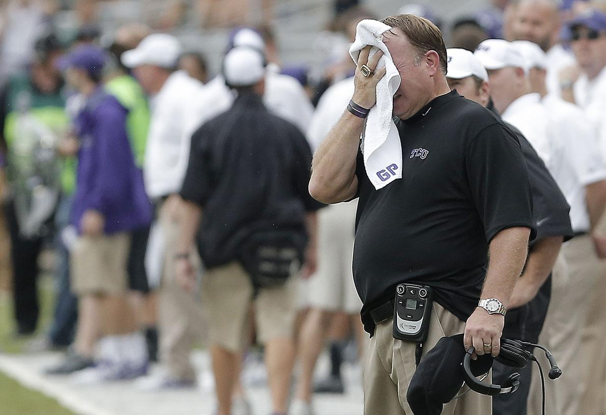 TCU head coach Gary Patterson, black shirt, looks on during the second half of an NCAA college football game against SMU Saturday, Sept. 28, 2013, in Fort Worth, Texas. TCU won 48-17. (AP Photo/Brandon Wade)