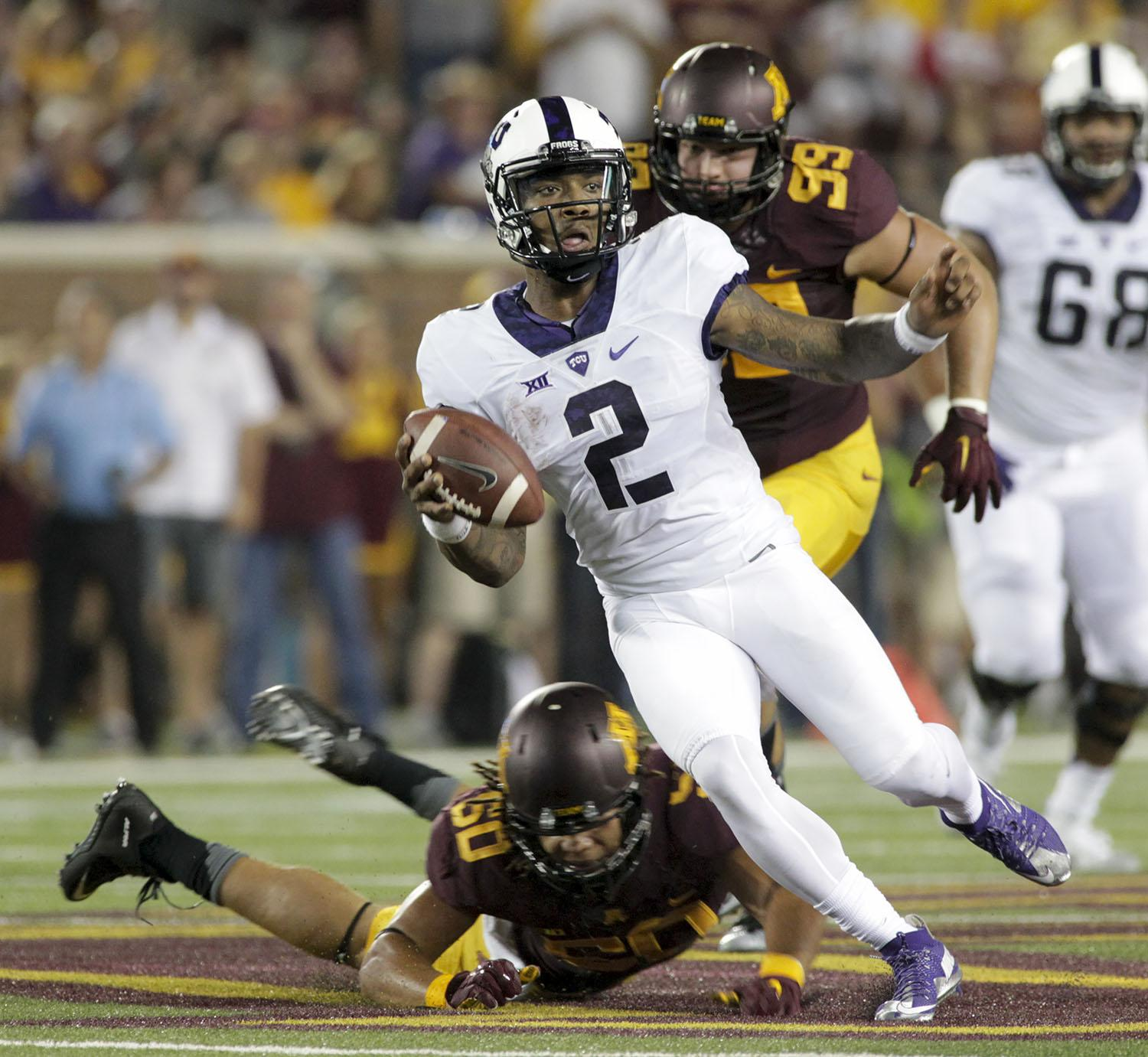 TCU quarterback Trevone Boykin (2) evades the tackle of Minnesota offensive lineman Matt Leidner (60) during the first half of an NCAA college football game Thursday, Sept. 3, 2015, in Minneapolis. AP Photo/Paul Battaglia)
