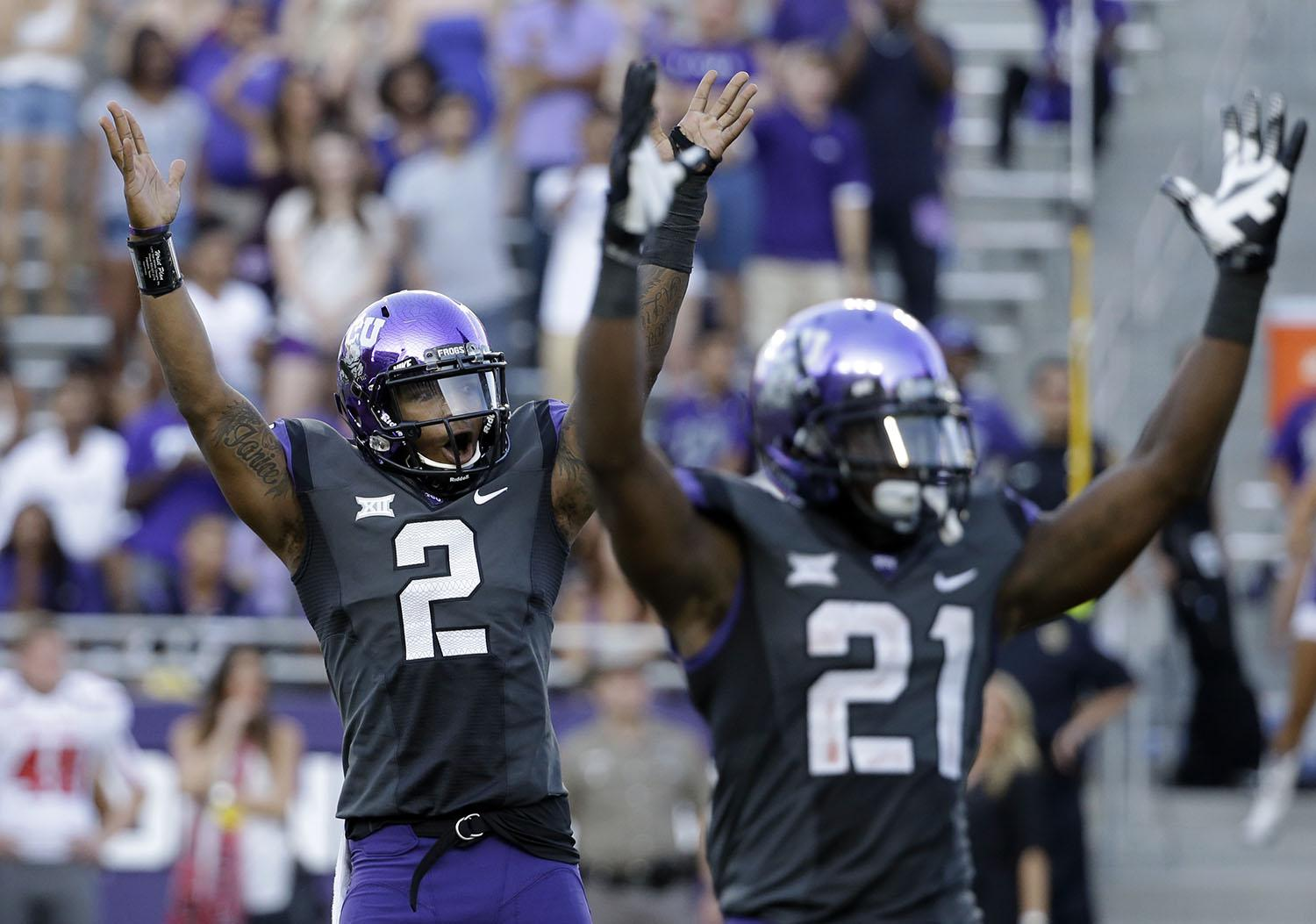 In this Oct. 25, 2014, file photo, TCU quarterback Trevone Boykin (2) and running back Kyle Hicks (21) celebrate after a touchdown against Texas Tech in the second half of an NCAA college football game in Fort Worth, Texas. TCU won 82-27. All that scoring caused this season's average length of game to hit 3 hours, 23 minutes in late November, according to the NCAA. (AP Photo/Tony Gutierrez, File)