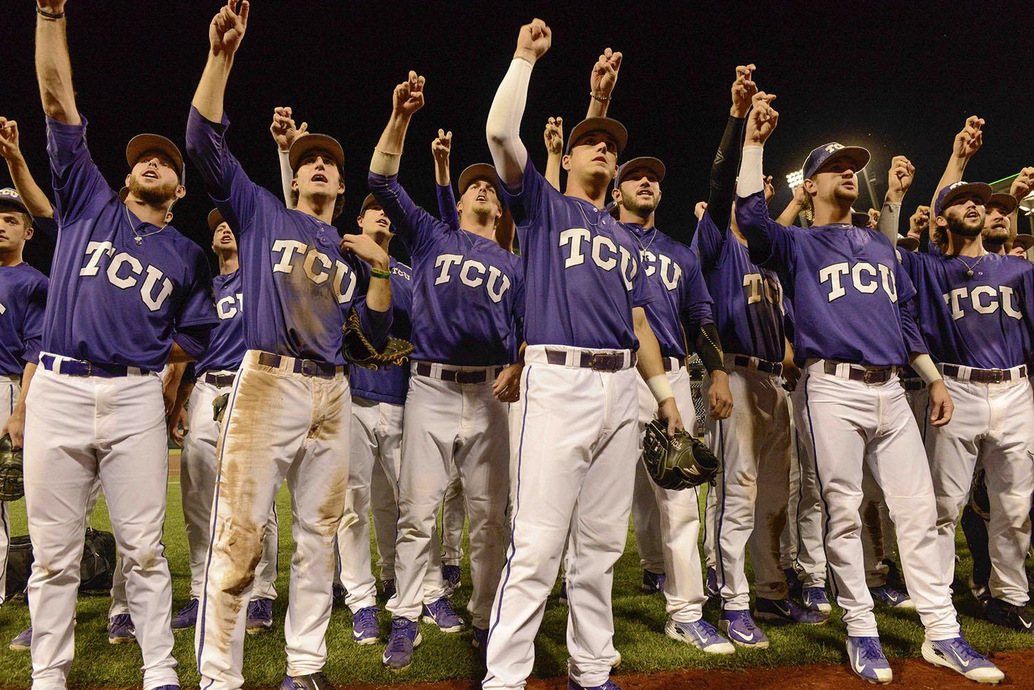TCU celebrates with the fans in the stands, following an NCAA College World Series baseball elimination game against LSU in Omaha, Neb., Thursday, June 18, 2015. TCU won 8-4, sending LSU home. (AP Photo/Mike Theiler)