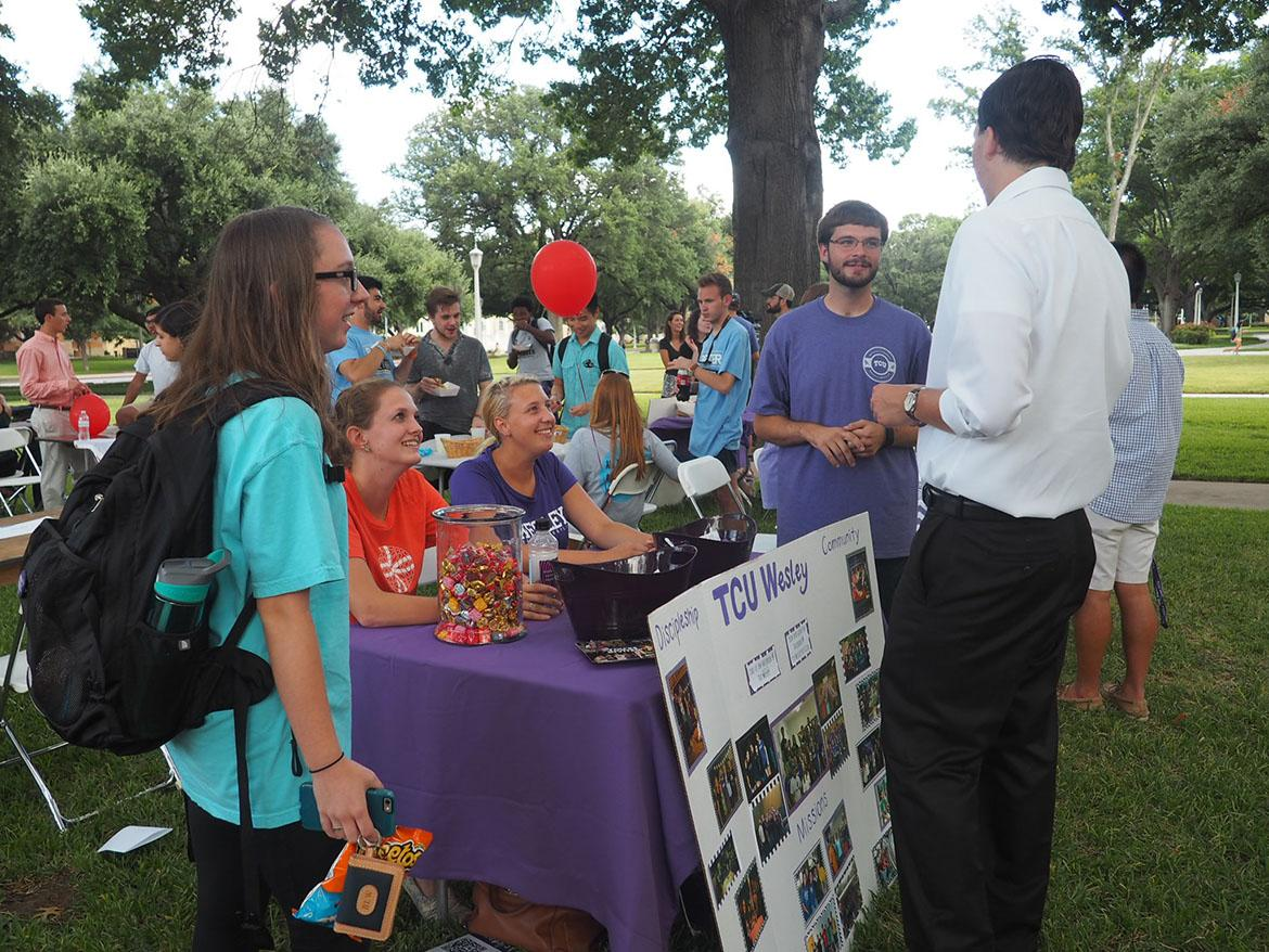 Members of TCU Wesley engaging with students at the Faith Festival.