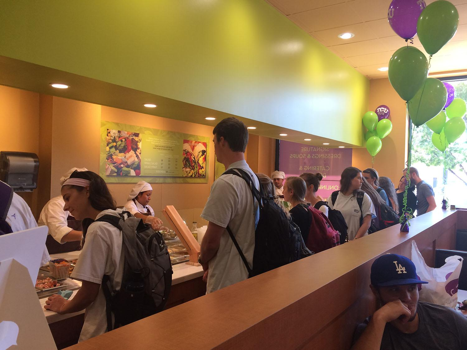 Students formed a long line at the grand opening of Berry St.'s Salata.