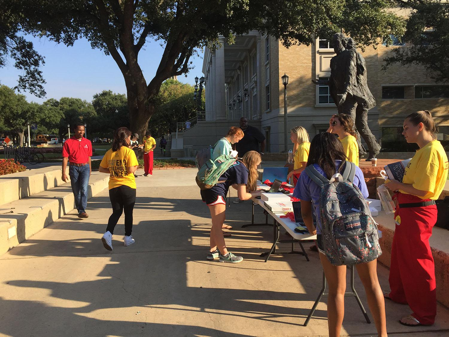Students registering for Up 'Til Dawn in front of the Founder's Statue.