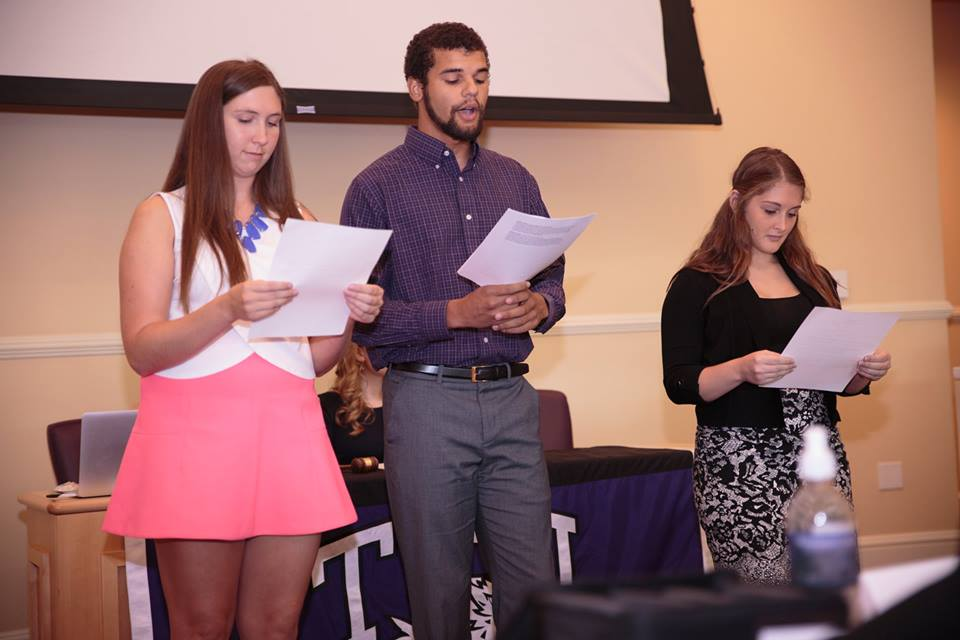From left to right, Katie Rettig, Adam Powell and Sam Koehler present the Resolution to the House of Student Representatives. Tuesday, Sept. 8, 2015.