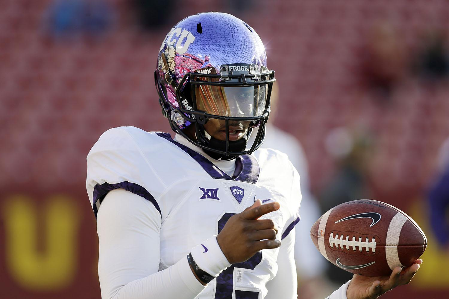 TCU quarterback Trevone Boykin warms up before an NCAA college football game against Iowa State, Saturday, Oct. 17, 2015, in Ames, Iowa. (AP Photo/Charlie Neibergall)