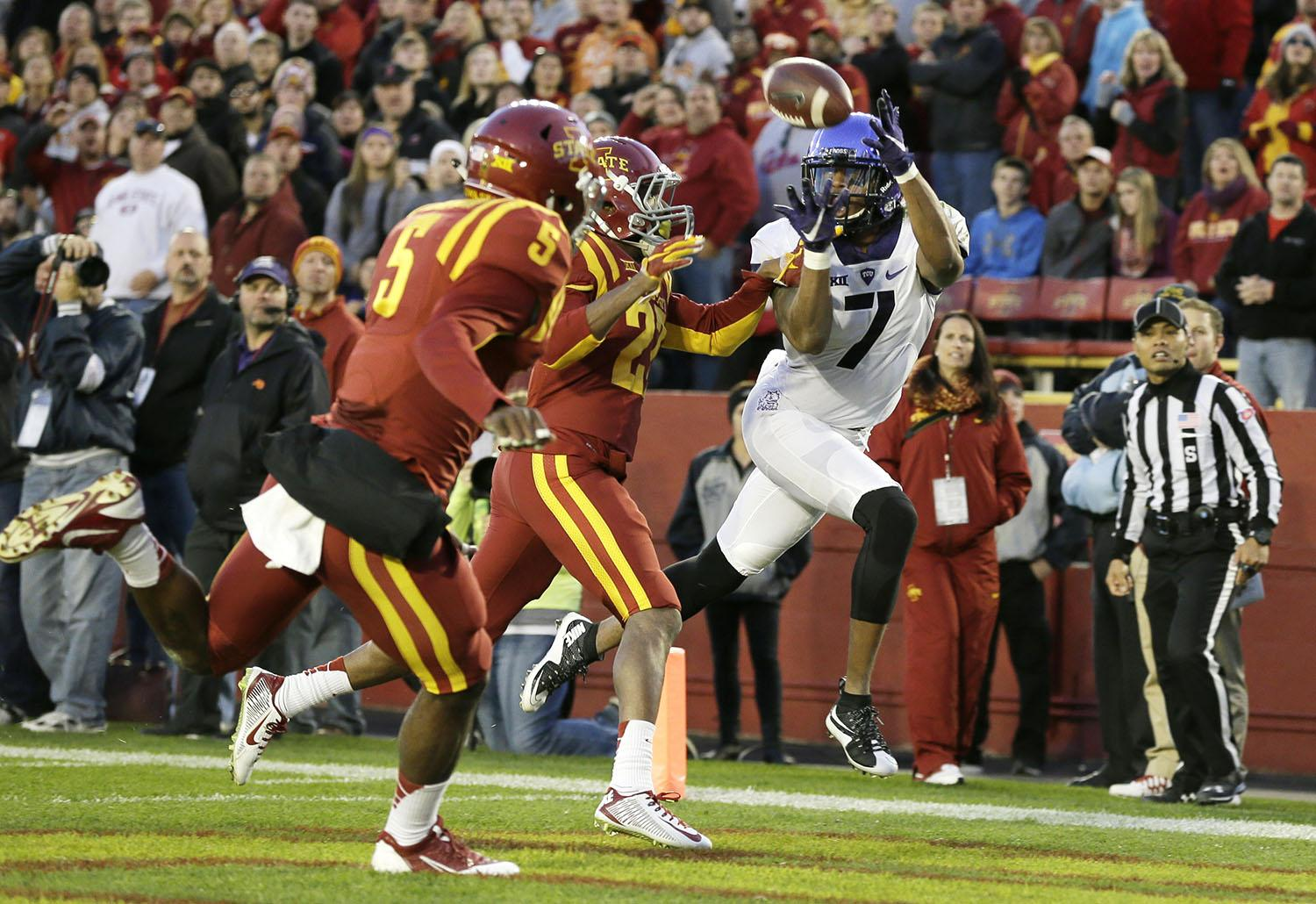 TCU wide receiver Kolby Listenbee (7) catches a touchdown pass in front of Iowa State defenders Kamari Cotton-Moya (5) and Kenneth Lynn, center, during the first half of an NCAA college football game, Saturday, Oct. 17, 2015, in Ames, Iowa. (AP Photo/Charlie Neibergall)