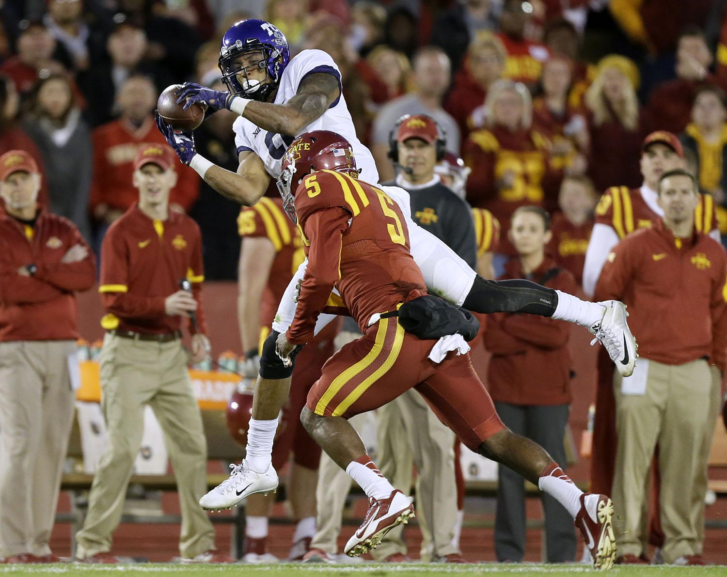 TCU wide receiver Josh Doctson, top, catches a pass over Iowa State defensive back Kamari Cotton-Moya (5) during the first half of an NCAA college football game, Saturday, Oct. 17, 2015, in Ames, Iowa. (AP Photo/Charlie Neibergall)