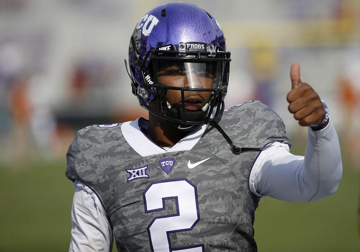 TCU quarterback Trevone Boykin gestures to a teammate before TCU takes on the Texas in a NCAA football game Saturday, Oct. 3, 2015, in Fort Worth, Texas. (AP Photo/Ron Jenkins)