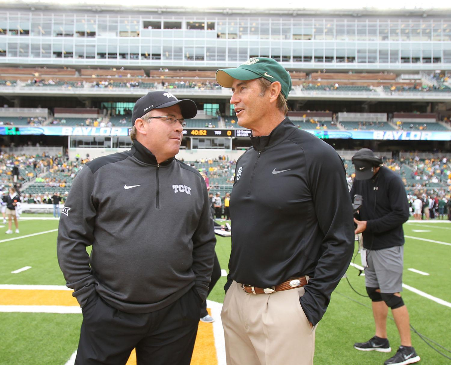 Baylor coach Art Briles, right and TCU Gary Patterson talks before their NCAA college football game, Saturday, Oct. 11, 2014, in Waco, Texas. (AP Photo/Jerry Larson)