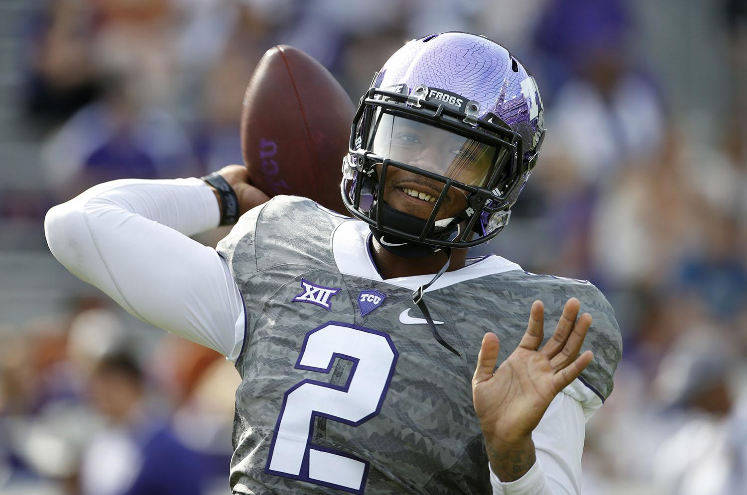 TCU quarterback Trevone Boykin (2) throws before the TCU Horned Frogs take on the Texas Longhorns in a NCAA football game Saturday, Oct. 2, 2015, in Fort Worth, Texas. (AP Photo/Ron Jenkins)