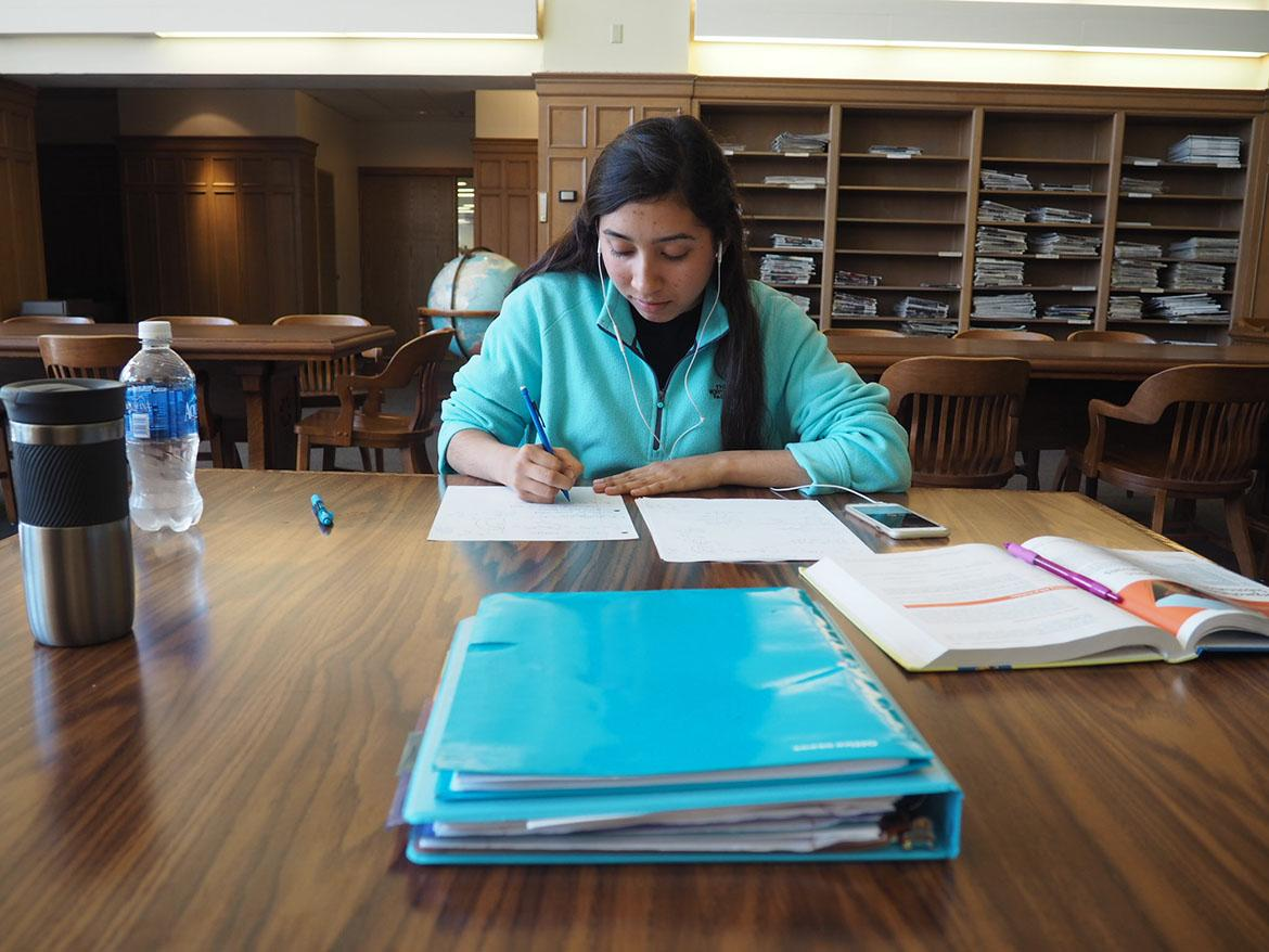 Junior biology major Leslie Gonzalez studies for organic chemistry in the periodical section of the Mary Couts Burnett Library.