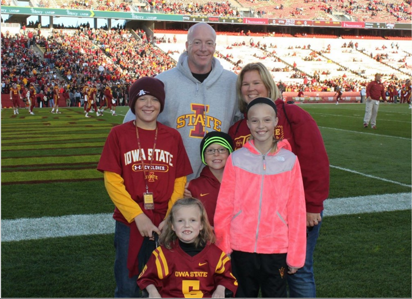 Abby Faber (bottom) and her family pose for a photo at the TCU-Iowa State game on Saturday, October 17. (Courtesy of Abby Faber's youcaring.com donation site)