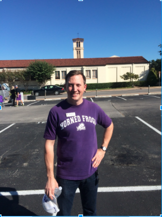 University Christian Church associate minister for youth Russ Boyd helps facilitate paid parking. Proceeds help fund a youth ministry program.