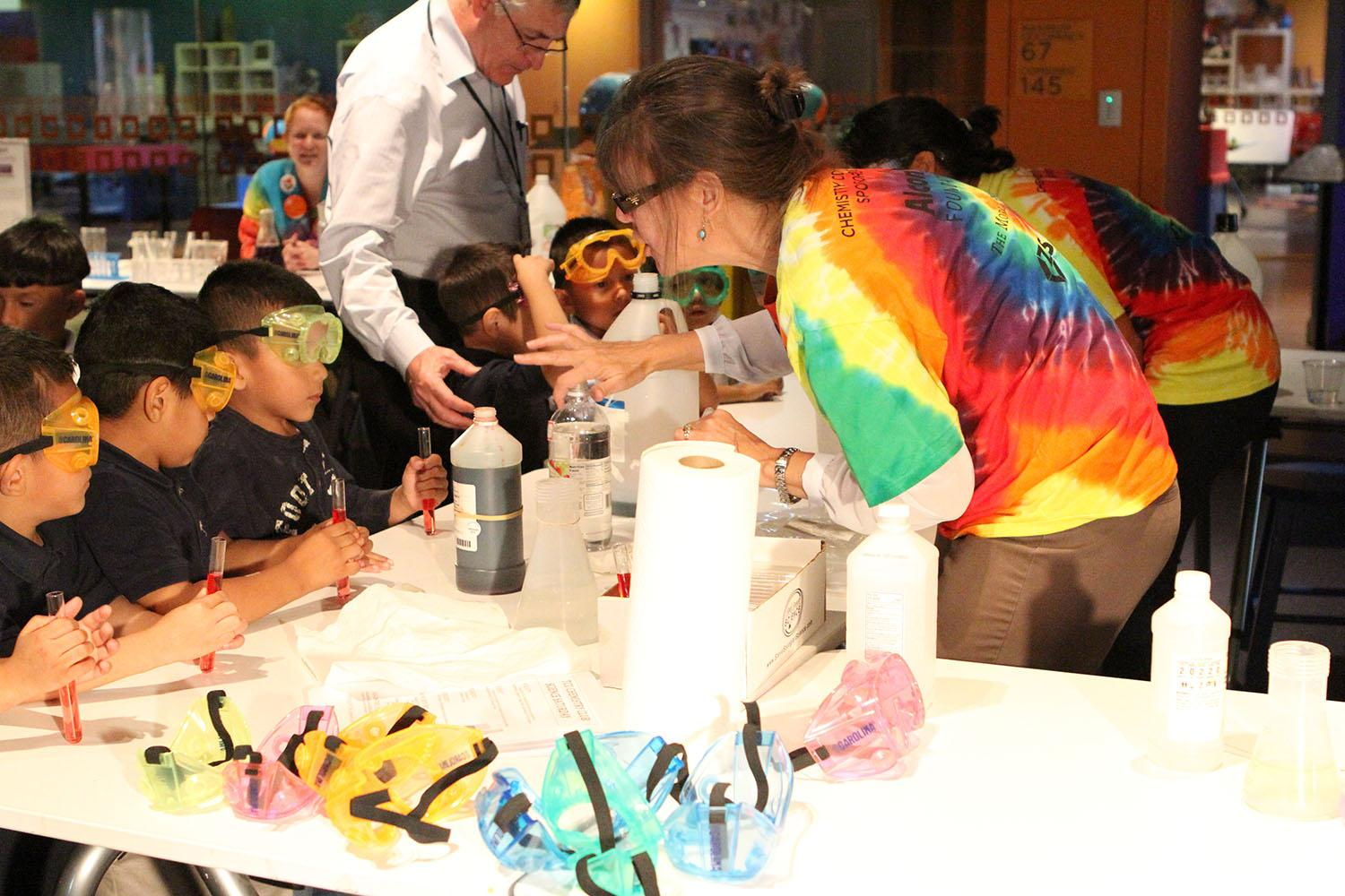 Kids experiment with colors in the Fort Worth Museum of Science and History