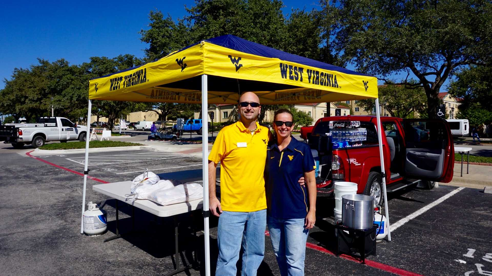 West Virginia tailgaters associated with the DFW Mountaineers arrived at TCU early to set up their tailgate outside of the Amon G. Carter Stadium.