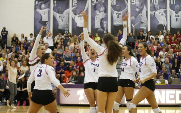 Horned Frog volleyball players celebrate during their win over Oklahoma in the University Recreation Center on Oct. 7, 2015.