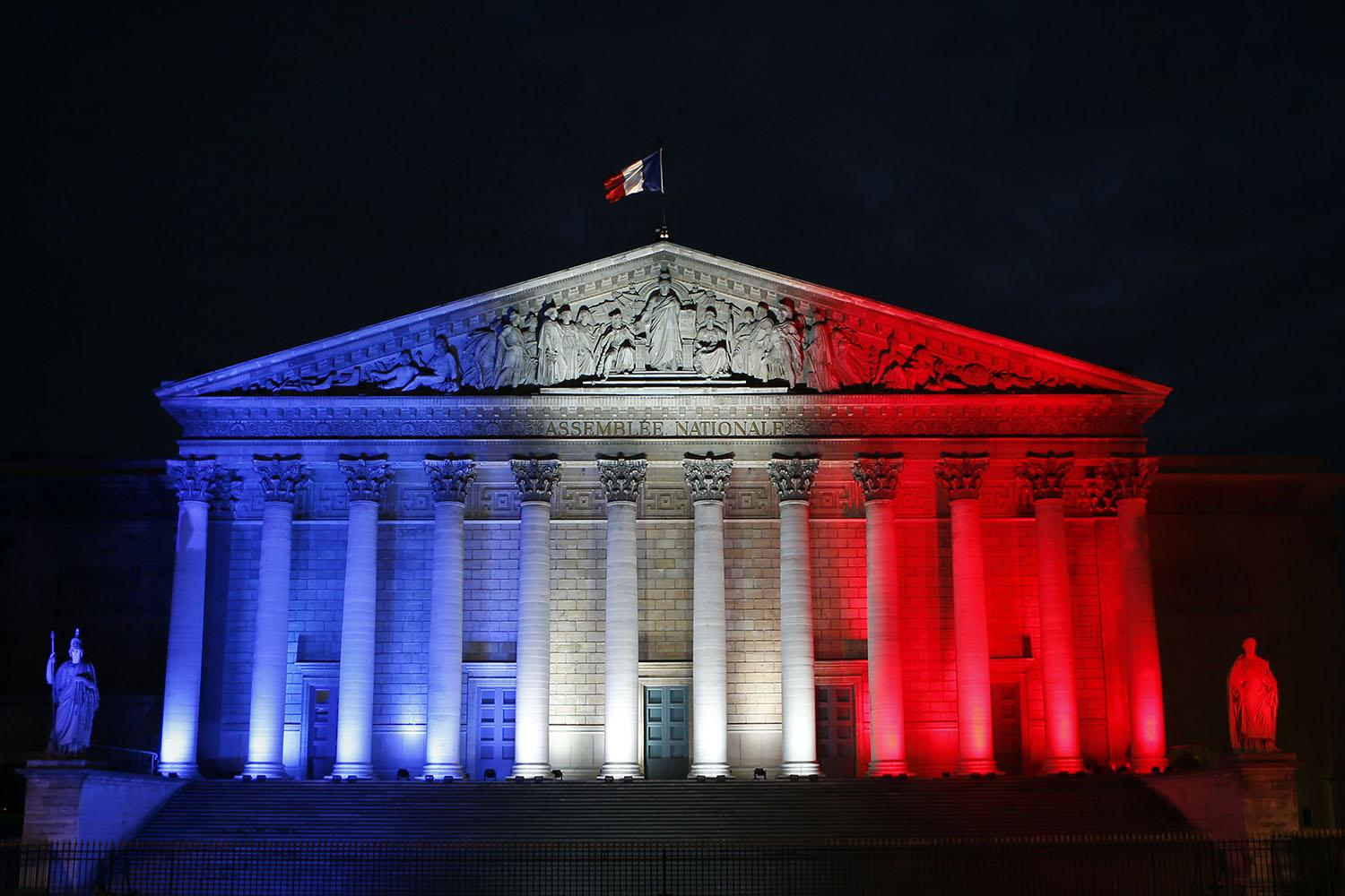 The French Assemblee Nationale which houses the bicameral Parliament is lit in the French National flag colors, in Paris, France, Sunday, Nov. 22, 2015 one week after the Paris attacks. Several TCU students and faculty are studying abroad in France, all of whom are accounted for and safe. (AP Photo/Francois Mori)
