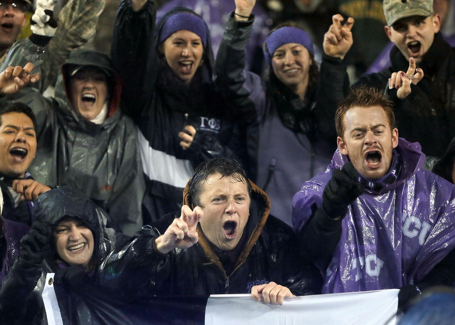 TCU fans cheer for their team during the first half of an NCAA college football game against Baylor, Friday, Nov. 27, 2015, in Fort Worth, Texas. (AP Photo/Tony Gutierrez)