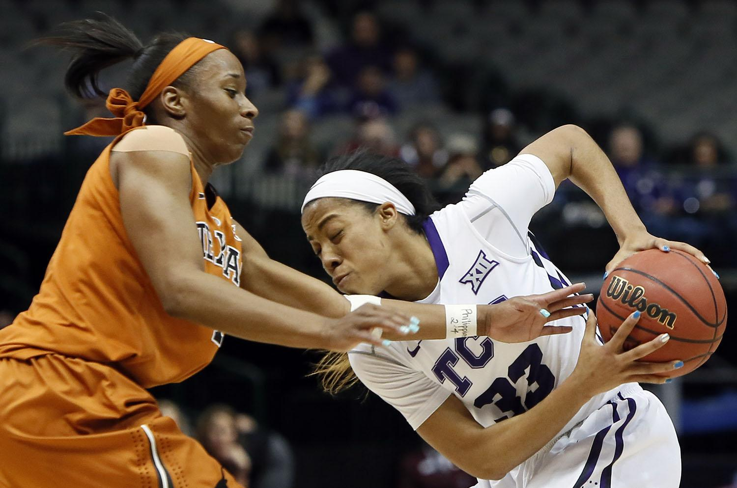 TCU guard Donielle Breaux (33) battles Texas guard Empress Davenport (1) for space during the first half of an NCAA college basketball game in the quarterfinals of the Big 12 Conference tournament, Saturday, March 7, 2015, in Dallas. Texas won 67-61. (AP Photo/Brandon Wade)