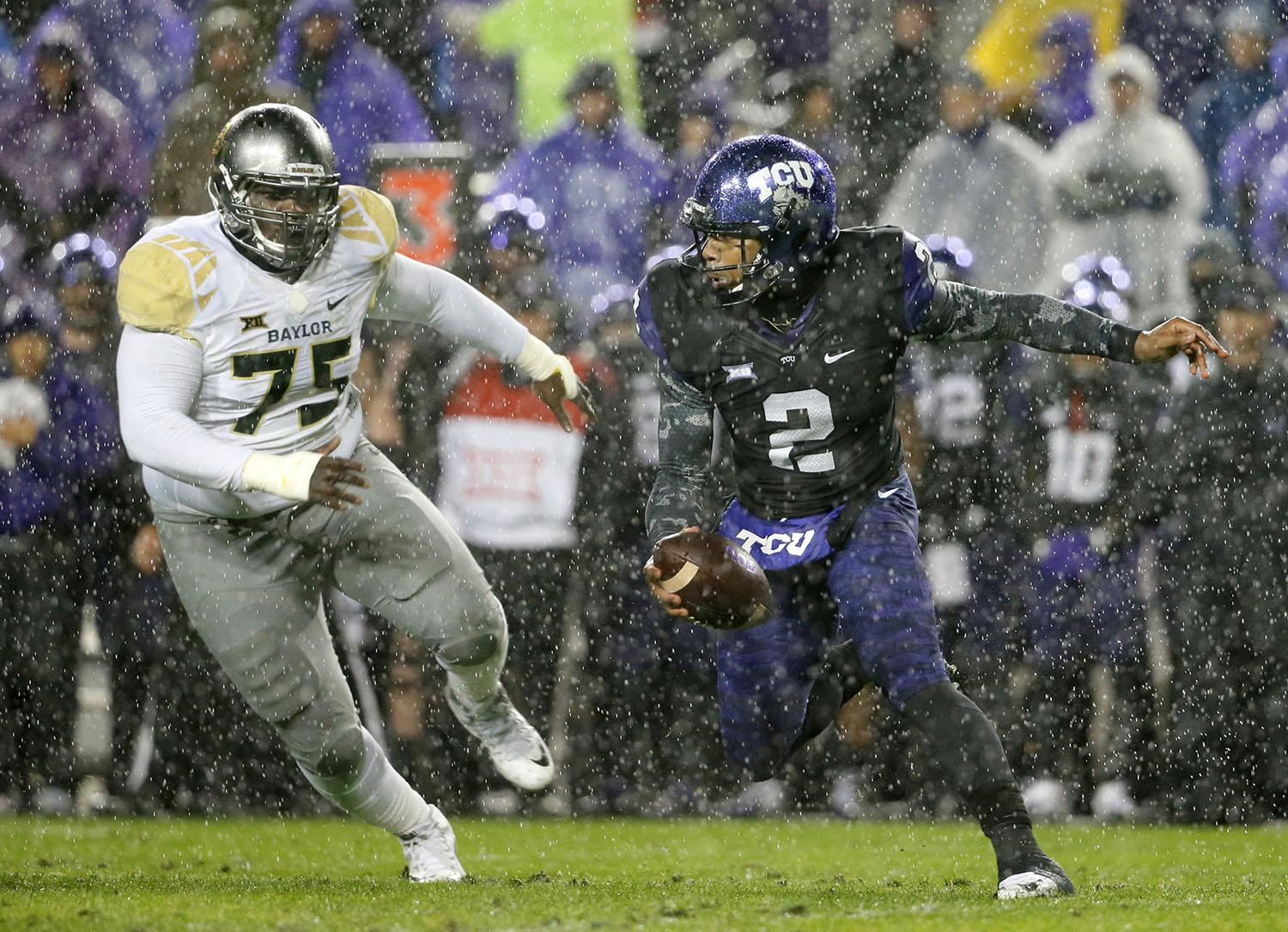 TCU quarterback Trevone Boykin (2) scrambles out of the pocket under pressure from Baylor defensive tackle Andrew Billings (75) in the first half of an NCAA college football game, Friday, Nov. 27, 2015, in Fort Worth, Texas. (AP Photo/Tony Gutierrez)