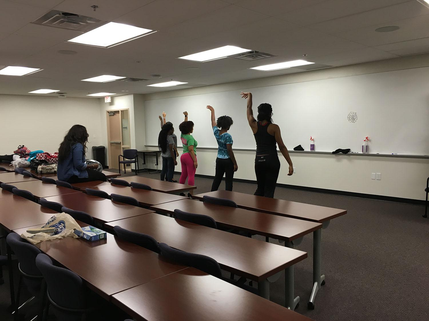 Five of the six Miss Black and Gold contestants practice for the upcoming pageant.