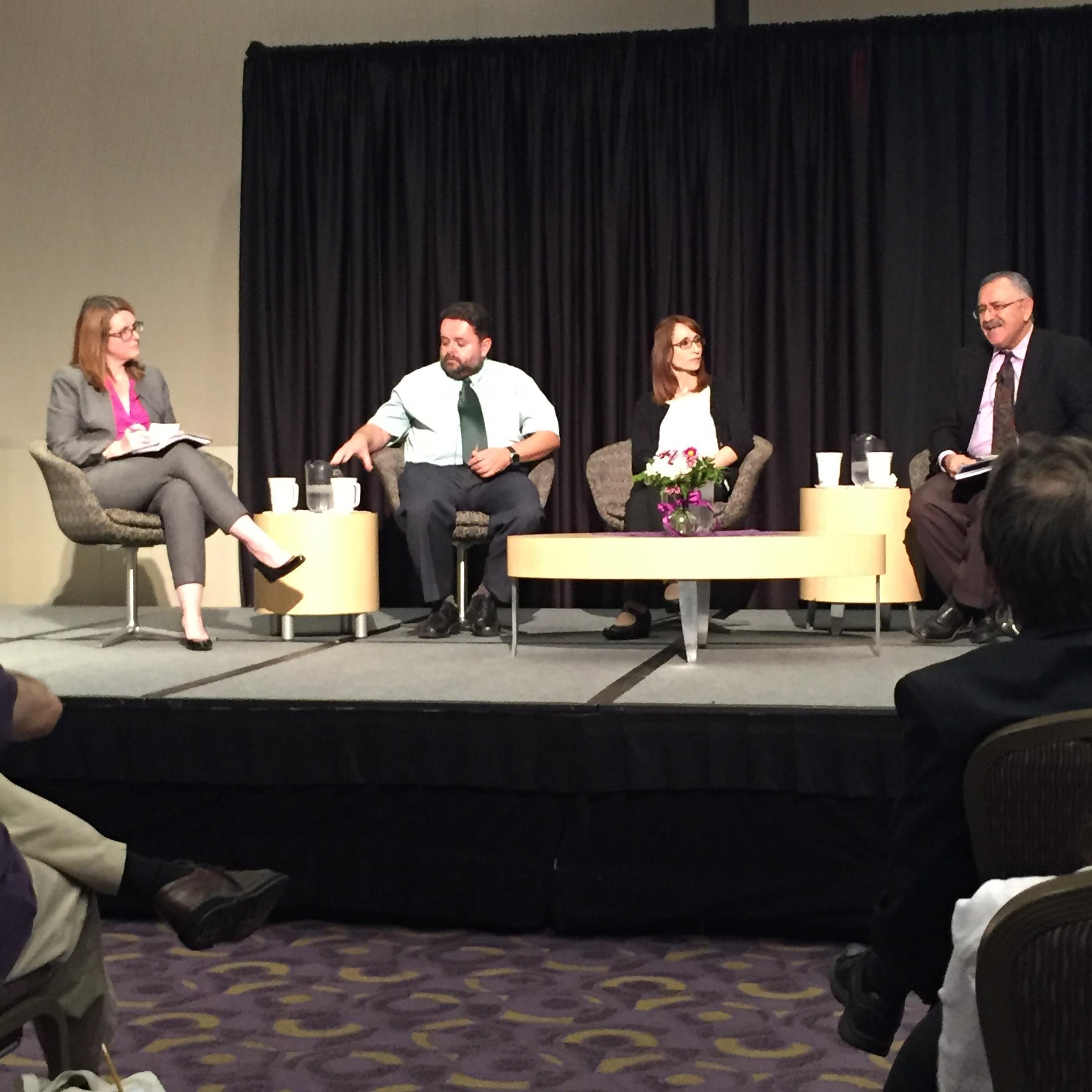 Amal Alachkar (center) discussing the current Syrian Refugee Crisis