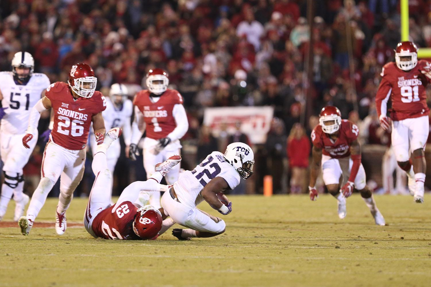Aaron Green is tackled in TCU's 30-29 loss to Oklahoma on Saturday, Nov. 21, 2015 in Norman, Oklahoma