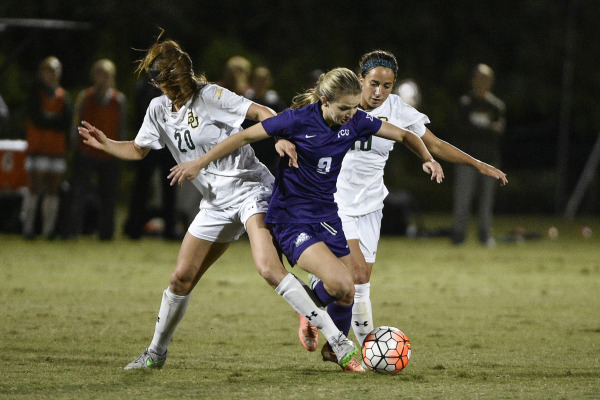 Kayla Hill attempts to escape two defenders in a draw against Baylor on Oct. 27 in Fort Worth.