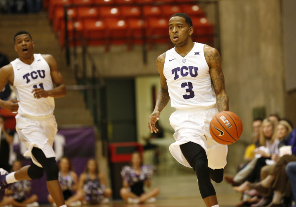 TCU guard Malique Trent dribbles the ball down the court.