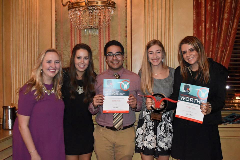 From left to right: Roxstars Whitney Machacek, Addy Kryger, Oscar Roel, Hayley Byk and Madison Gottlieb attended the Worthy Awards on November 5 at the Fort Worth Club. Roxo's President Roel, here pictured holding an Award of Achievement, worked on the Revitalize Charging Solutions team. Gottlieb, account executive, holds a Worthy Award alongside coworker Byk in recognition of her team's work for Fort Worth Bike Sharing. Roxstars Machacek and Kryger were not members of the award-winning teams but do serve as copywriter and social media manager, respectively, for Roxo, according to Roxo's website.