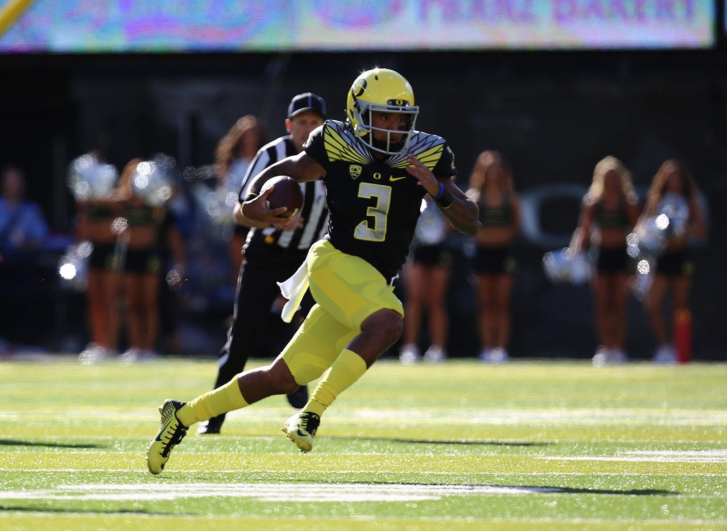 Oregon quarterback Vernon Adams Jr. (3) runs the ball during the first half of an NCAA college football game against Eastern Washington Saturday, Sept. 5, 2015, in Eugene, Ore.