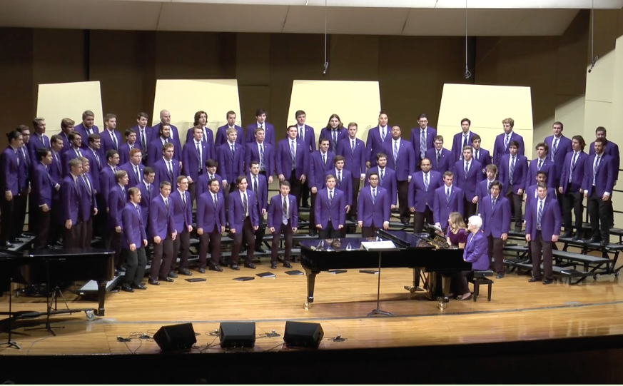 TCU Frog Corps performs Jingle Bells at the annual combined choirs Christmas concert.
