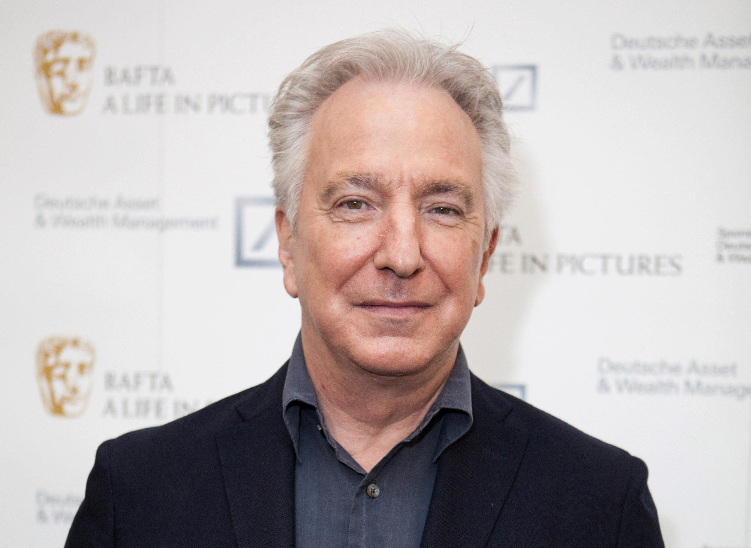 In this April 15, 2015 file photo, actor Alan Rickman poses for photographers on arrival at 'BAFTA A Life In Pictures, with Alan Rickman'  in central London.
