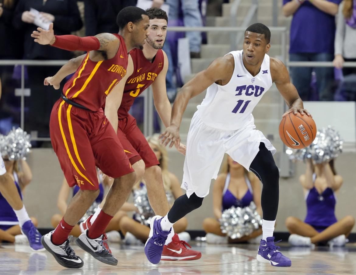 Iowa State's Monte Morris, left, and Georges Niang, center, defend as TCU guard Brandon Parrish (11) moves the ball around the perimeter during the first half of an NCAA college basketball game, Saturday, Jan. 23, 2016, in Fort Worth, Texas.