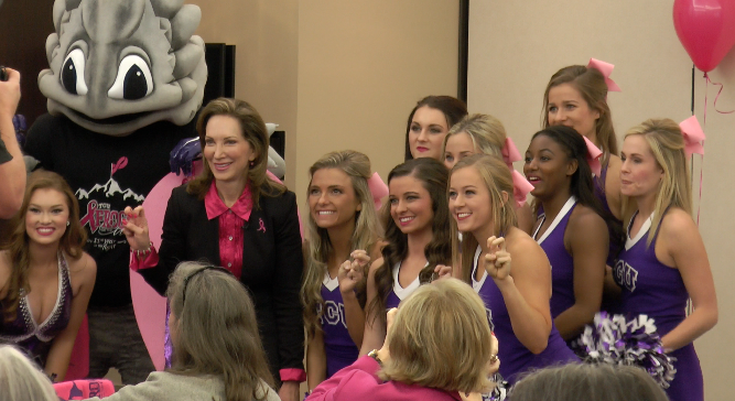 TCU Cheer and Super Frog join Frogs for the Cure Chair Ann Louden at the thank you celebration.