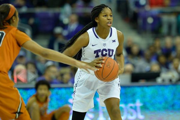 TCU's Jada Butts looks to pass against No. 6 Texas in Schollmaier Arena in Fort Worth on Jan. 20, 2015.