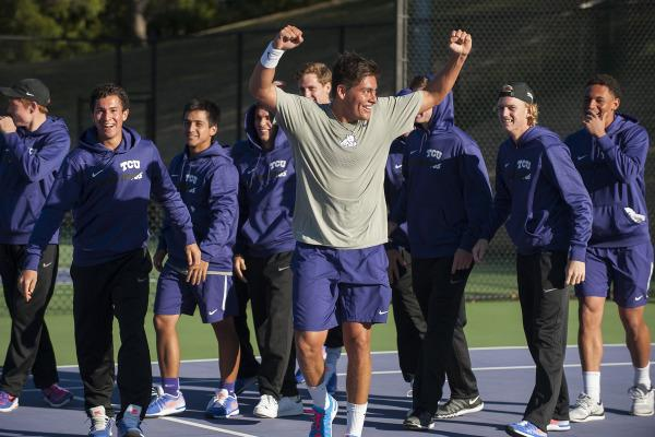 Jerry Lopez celebrates with his teammates after sending TCU through to the ITA national tournament with a win against Oklahoma State on Jan. 25.