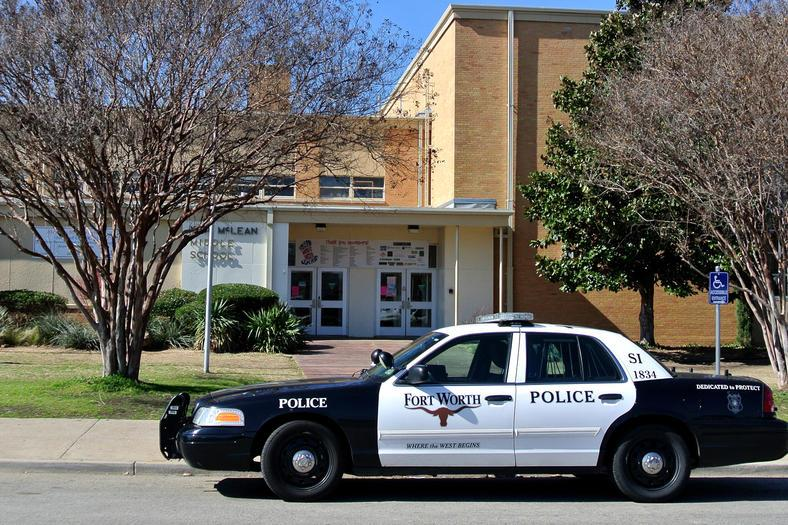 A Fort Worth police car sits in front of McLean Middle School after a reported stabbing. The student later recanted his story, saying he was playing before class and tore his shirt. The student made up the incident so that he would not get into trouble.
