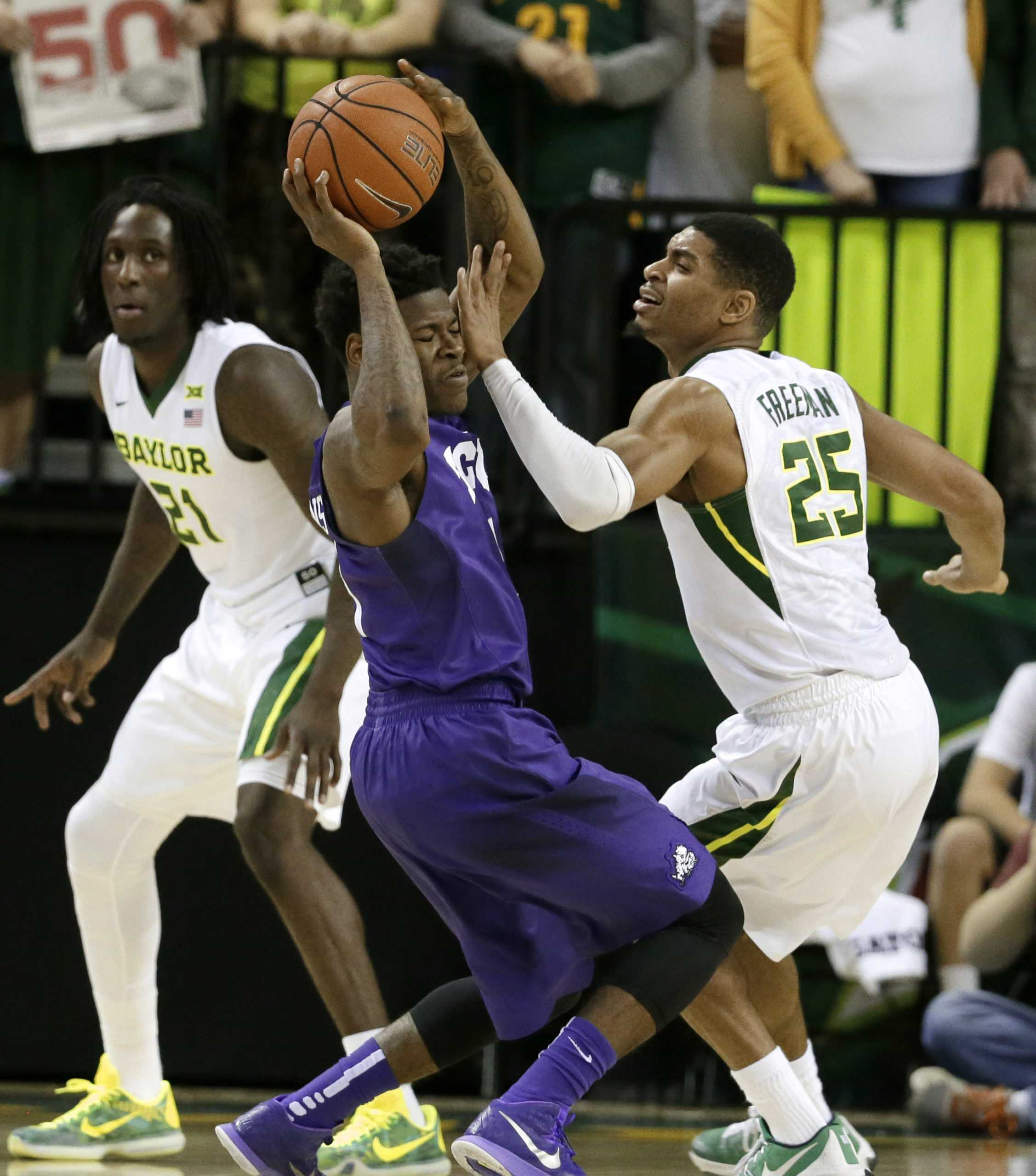TCU's Chauncey Collins, center, attempts to get to the basket as Baylor's Taurean Prince (21) and Al Freeman (25) defend in the second half of an NCAA college basketball game, Wednesday, Jan. 13, 2016, in Waco, Texas. Baylor won 82-54. (AP Photo/Tony Gutierrez)