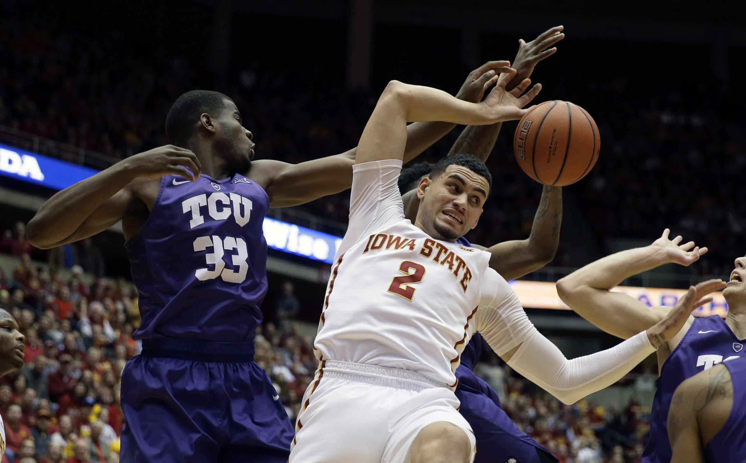 TCU forward Chris Washburn, left, fights for a rebound with Iowa State forward Abdel Nader (2) on Feb. 20.
