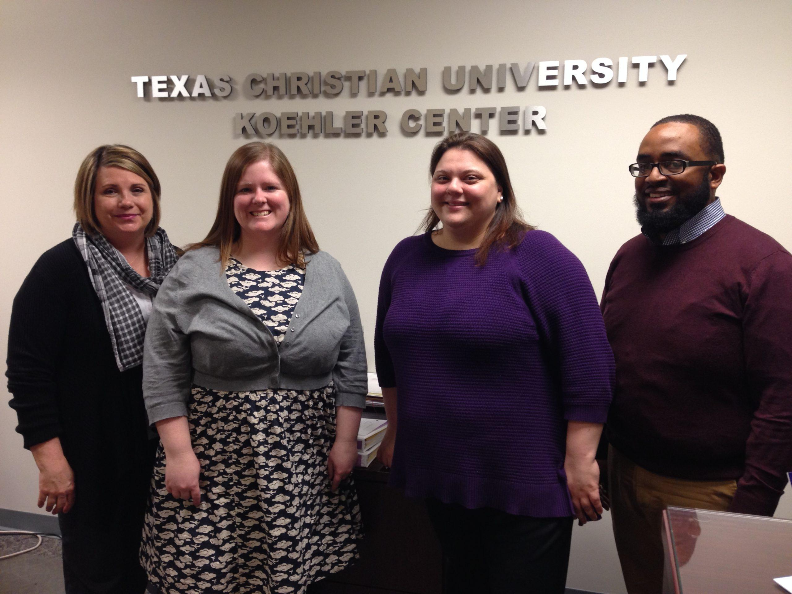 Romana Hughes, Kerrie Meister, Joanna Schmidt and Desmond Morris are leading the transition from eCollege to TCU Online. They are pictured here on Monday, Feb. 22, 2016, in Fort Worth, Texas.