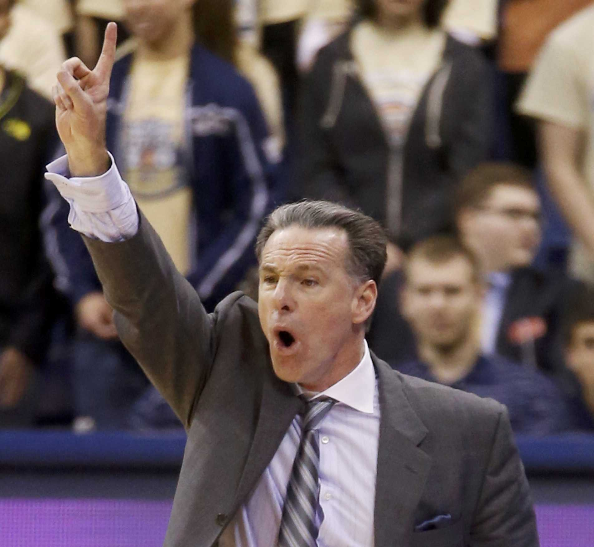Pittsburgh head coach Jamie Dixon calls signals to his team against Wake Forest on Jan. 11, 2014.