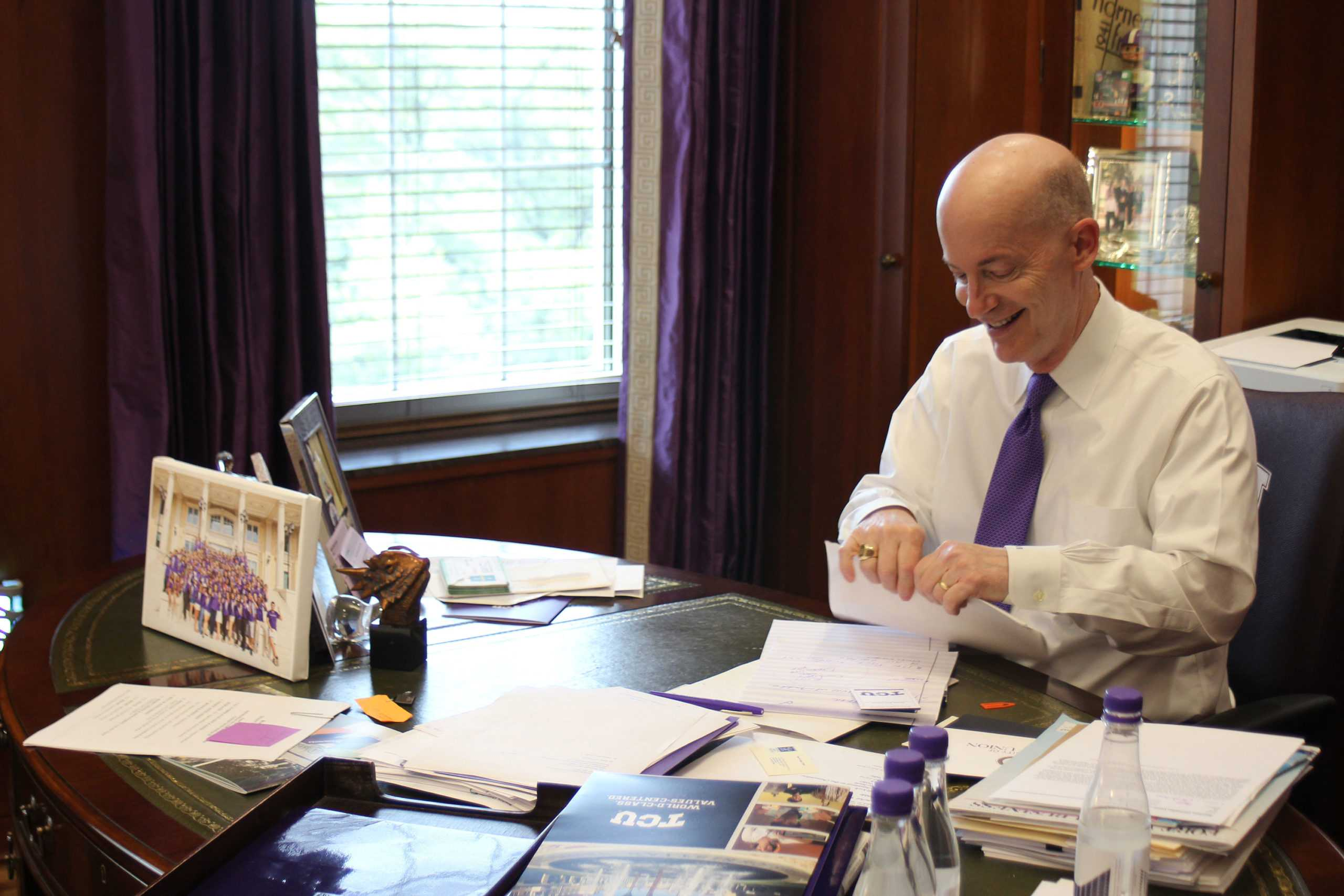 Chancellor Boschini is responsible for signing every graduating students' diploma.