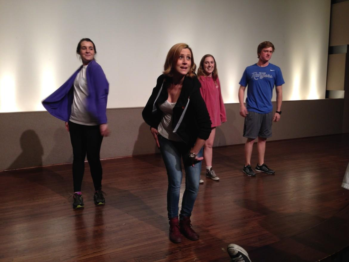 Lydia Mackay, an adjunct in the theater department, leads her Survey of Theater class in a warmup on Feb. 11.