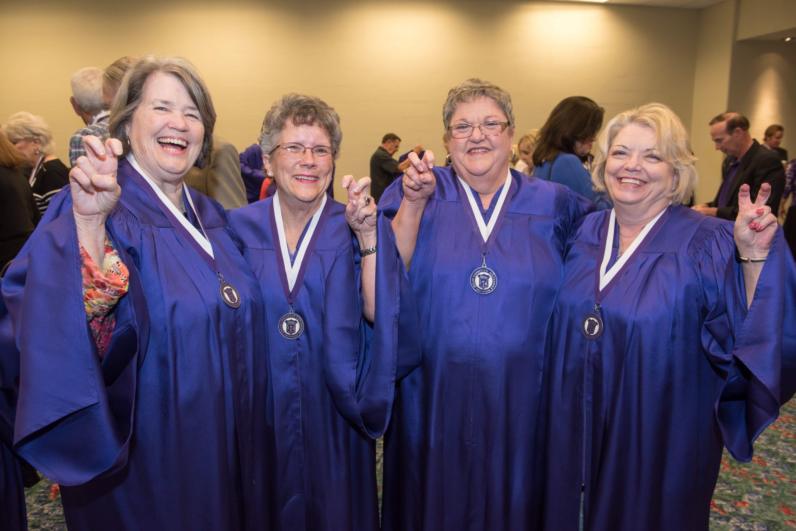 Members of the class of 1966 will wear a purple cap and gown one more time to walk in the graduation procession during spring commencement.