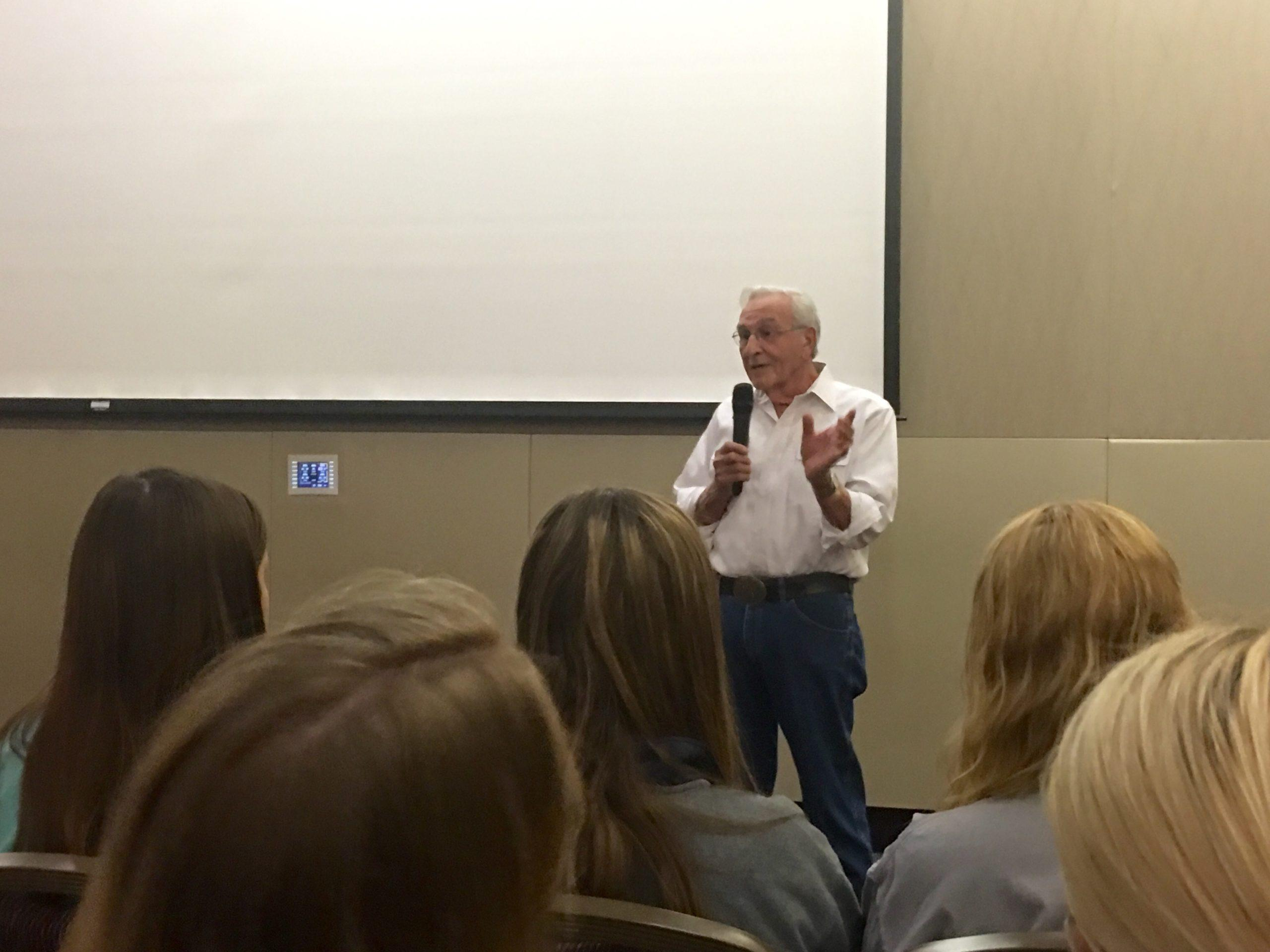 Holocaust survivor Harry Kahn speaks to students, faculty and community members.
