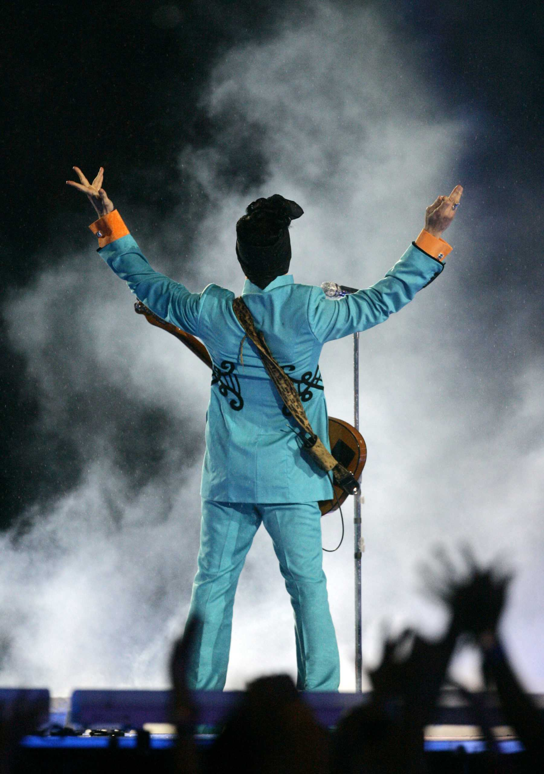 FILE - In this Feb. 4, 2007 file photo, Prince performs during the halftime show at Super Bowl XLI at Dolphin Stadium in Miami. Prince's publicist has confirmed that Prince died at his home in Minnesota, Thursday, April 21, 2016. He was 57.